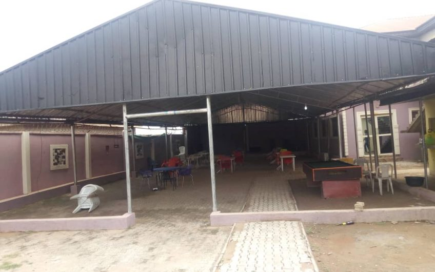 FOR SALE  A functional Event Centre /VIP Hall of 100 sitting capacity with Motel of 15 Rooms, Laundry and Salon all on 3 Plots of land