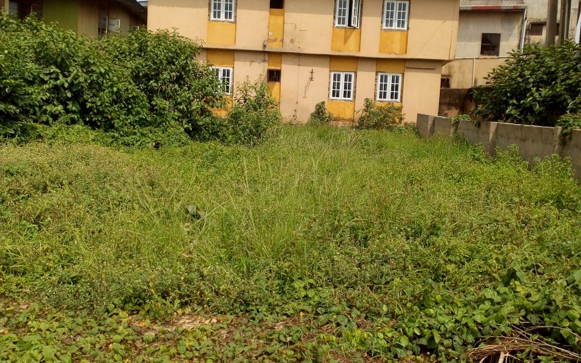 For Sale: A plot of land with a storey building comprising 2No. 2bedroom Flat.